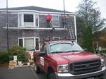 Installation of new white cedar shingles for law office in Chatham, MA